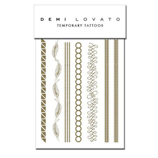 Demi Lovato,: Gold Flash Tattoos